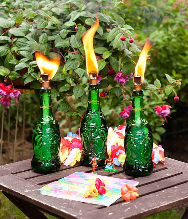 DIY Tiki torches for a Tropical party: Luau, Hawaiian, or Moana themes. Small World gets big with cultural party themes | Halfpint Design