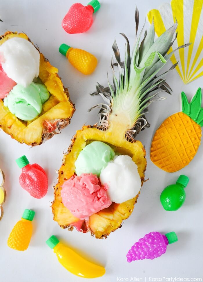 Pineapple ice cream bowl. So yummy for a Tropical party: Luau & Hawaiian. Use a coconut for a Moana theme. Small World gets big with cultural party themes | Halfpint Design