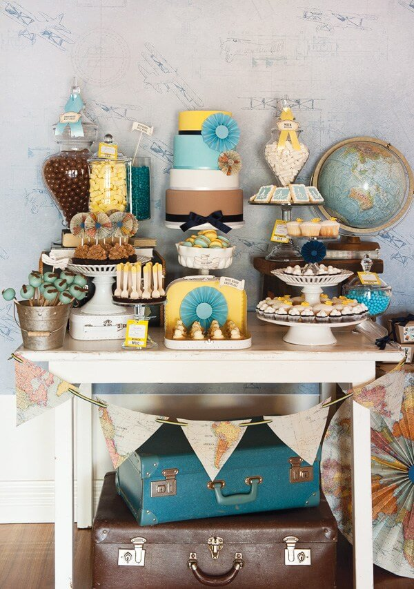 Vintage travel party themes are some of my favorite. The luggage, globes, and maps make it! Small World gets big with cultural party themes | Halfpint Design