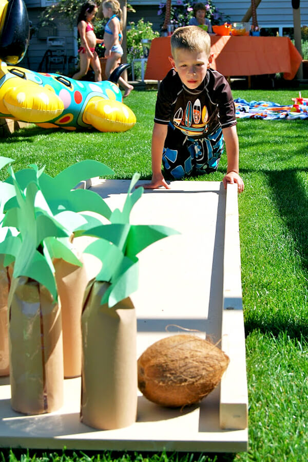 Party activities for boys 3-5 | Halfpint Design - Coconut bowling is a great activity for a Tropical Party, Pool Party, or Luau