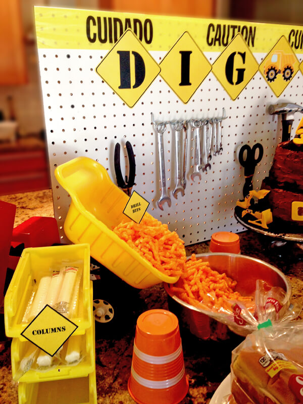 """Construction Party Menu   Halfpint Design - Cheetos from the dump truck is so classic! Love the barrel cups, and cheese stick """"columns"""""""