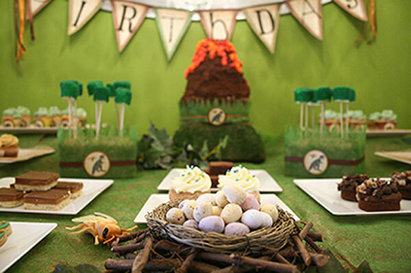 Dinosaur Party. Greenery Inspired Parties   Halfpint Design - This green backdrop is awesome for a dinosaur party. I love the volcano cake, moss cake pops, and dino eggs.