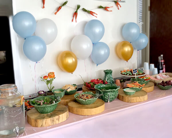 Peter Rabbit in Mr. McGregor's Garden First Birthday Party | Halfpint Design - Food buffet with cabbage serving ware.