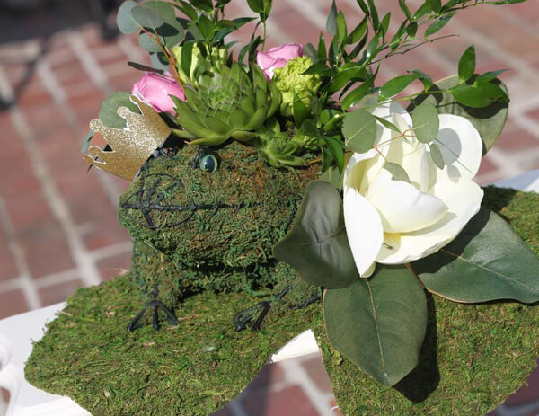 Princess and the Frog party. Greenery Inspired Parties | Halfpint Design - this frog centerpiece is so elegant. Frogs take on a feminine touch with this Princess and the Frog party