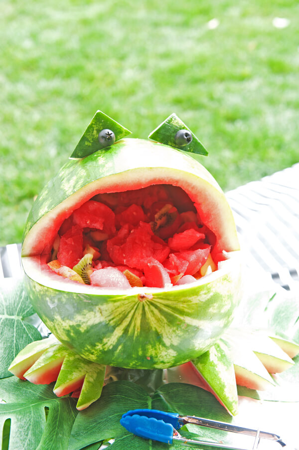 Frog party. Greenery Inspired Parties | Halfpint Design - This watermelon frog bowl was such a cute addition to the food table for a Jungle party, Frog party.