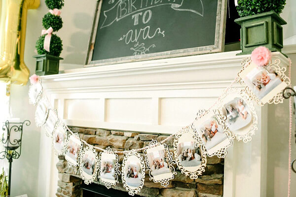 Planning Your First Children's Birthday Party | Halfpint Design - First birthday decoration. Photo banner of the birthday child photoshoot, or a timeline from every month. Such a cute idea for party decor
