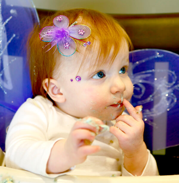 "Butterfly First Birthday Party | Halfpint Design - Enjoying her ""cake"" a little tentatively. Why are they all still here watching me?"