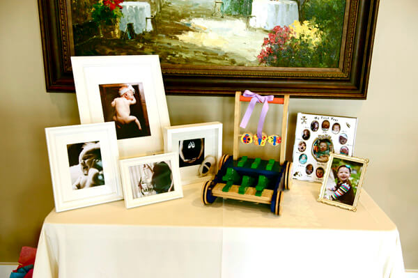 Butterfly First Birthday Party | Halfpint Design - Entry display to showcase the last 13 months of her life.
