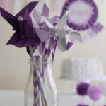 A Passion for Purple | Halfpint Design - Purple pinwheels and pom poms for a purple party