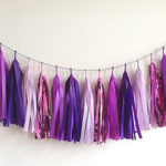 "A Passion for Purple | Halfpint Design - ""Purple rain"" party tassel garland is a beautiful addition to any purple party."