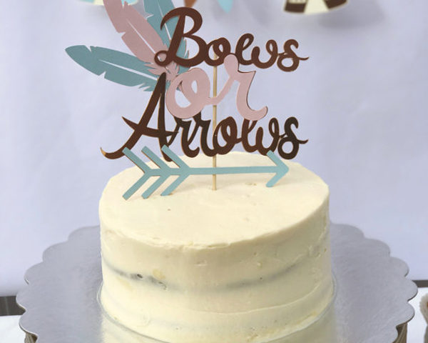 Bows and Arrows Gender Reveal Party Ideas   Halfpint Design - Bows or arrows cake topper is a nice addition to a gender reveal party.