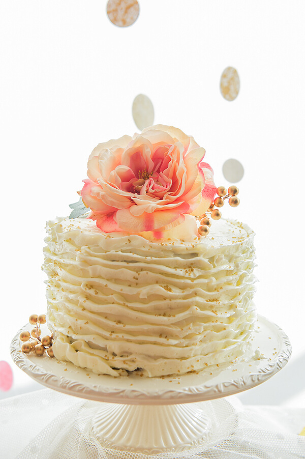 Vintage Coral & Gold Baby Shower | Halfpint Design - This beautiful vintage themed chocolate cake features buttercream ruffles, a coral rose topper, and gold sprinkles