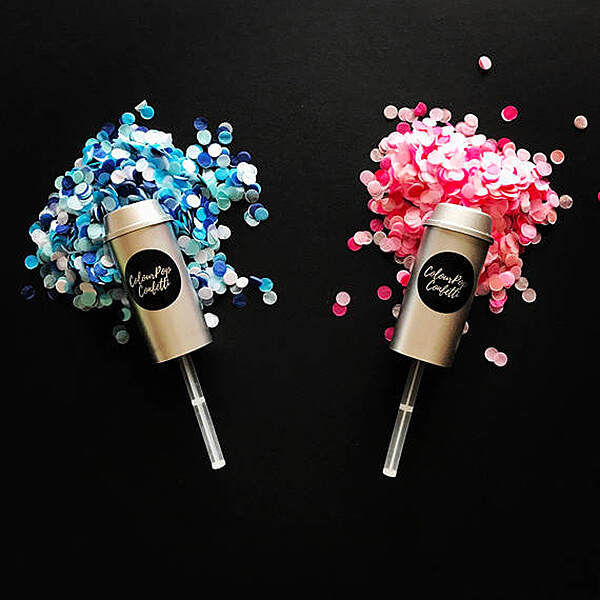 10 Ways to Reveal Baby's Gender | Halfpint Design - Confetti is so much fun. Especially when it's used to announce the gender of your baby! These popper are perfect party favors for the guests to enjoy the announcement too!