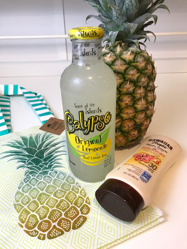 Tropical End of Year Teacher Gift Idea | Halfpint Design - Tropical fun bag contents, pineapple, lemonade, and Hawaiian Tropics sunscreen