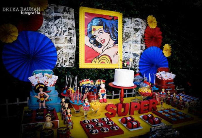 This comic inspired party backdrop is fantastic with the printed pages and iconic Wonder Woman focal point. Comic Strip Wonder Woman Party | Halfpint Design, party ideas, party themes