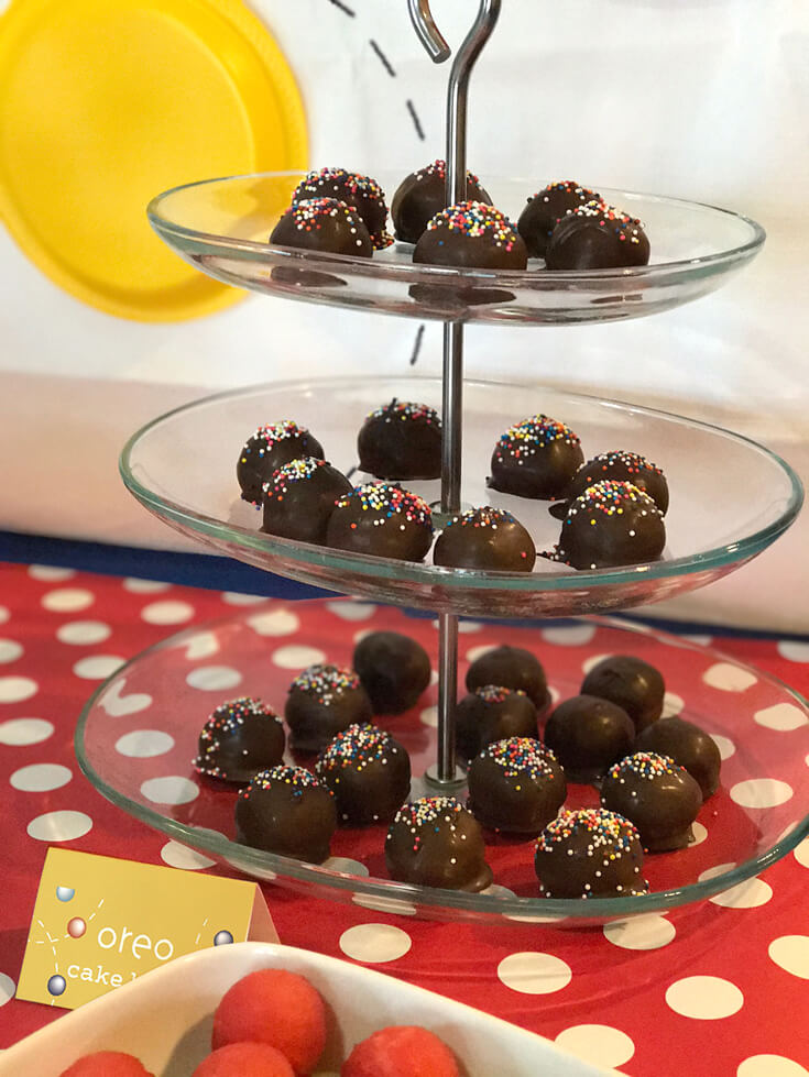 Ball Party Event Menu | Halfpint Design - And we finished off dinner with Oreo cake balls. Everyone was so excited about the cake balls that they didn't even miss a cake. We stuck a candle in a ball and sang. Little man was happy as can be! Ball party food ideas.