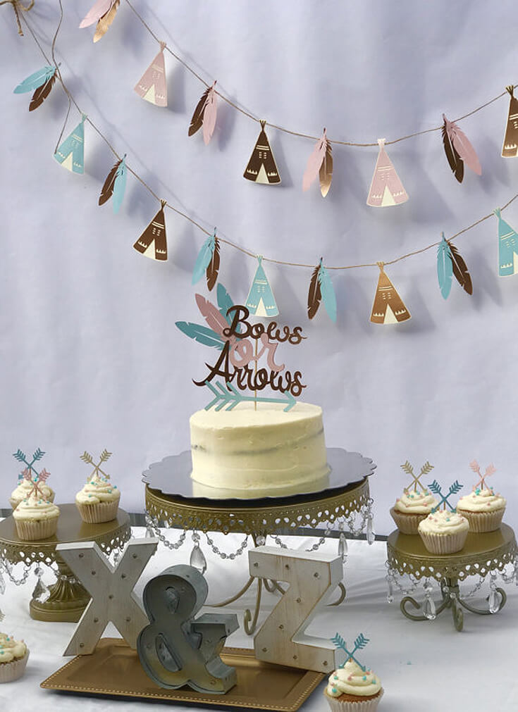 Bows or Arrows: Gender Reveal Party Ideas | Halfpint Design - This teepee and feather cut paper garland is darling! A great backdrop for a bows or arrows gender reveal, Boho baby shower or Wild One birthday party.