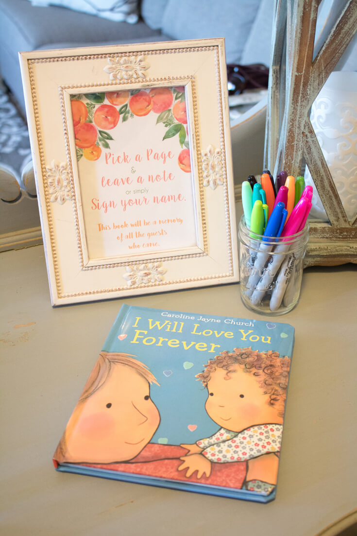 """I love when baby shower items can be used again. Having Mommy-to-be's childhood favorite """"I Will Love You Forever"""" as the sign in book ensures she and Georgia will see guests love notes over and over again. - Sweet Little Peach Baby Shower   Halfpint Design"""