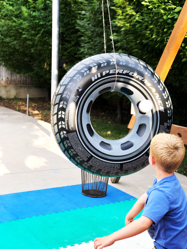 "The ""Hole Shot"" activity was a tough one for the 5 year old crowd. Toss a ball through the open hole of huge inflatable tires. For older kids have the tires spin slowly for an added challenge. Monster truck party activity ideas 