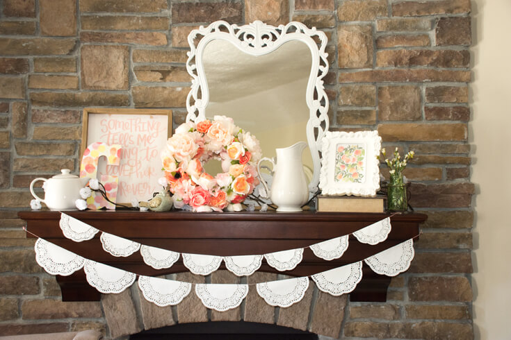 "Choose your focal points. This mantel is a prominent feature and styling it with additional nursery decor was a great idea. A ""G"" for Georgia, another piece of sweet nursery art ""Something tells me I'm going to love her forever"", and a lovely floral wreath made my mommy-to-be. The doilie garlands are so cute and very easy to make. - Sweet Little Peach Baby Shower 