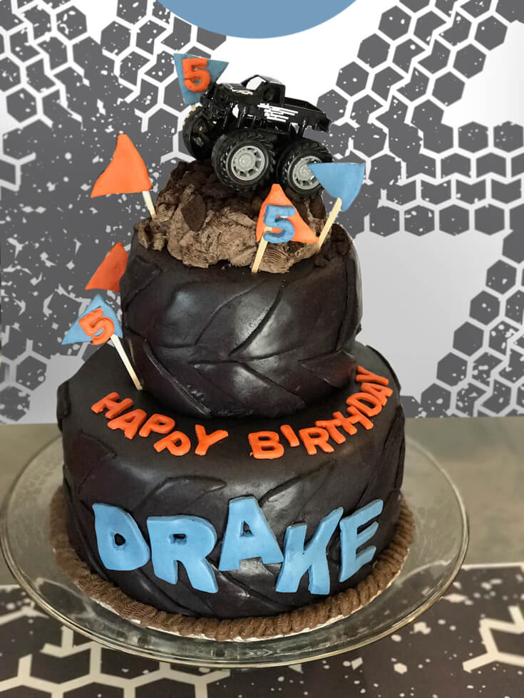 Awesome Monster Truck Tire birthday cake by Emily Knowles. Monster Truck Party Menu | Halfpint Design - party food, event menu