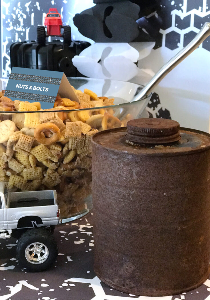 Small accents create a beautiful display. Bringing in a rusty oil can and toy monster truck tied design elements together. Monster Truck Party Menu | Halfpint Design - party food, event menu