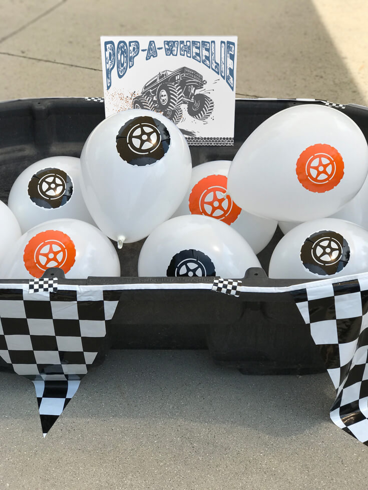 "I think this ""Pop a wheelie"" might have been the favorite! It definitely was the first activity all the guests did. Sit on the tire balloon and pop the ""wheelie"" - Monster truck party activity ideas-halfpintpartydesign.com-boy party theme"