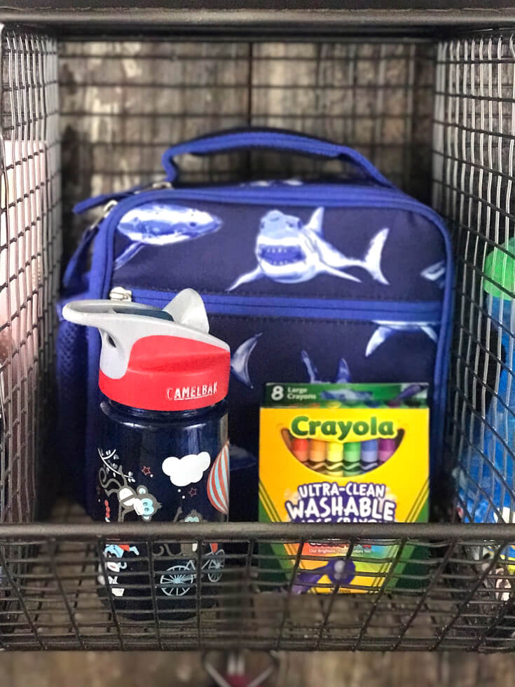 Each child had a bin. My preschool bin holds his lunchbox, waterbottle, and art supplies for easy grabbing on the go. Farmhouse Back to School Organization | Halfpint Design