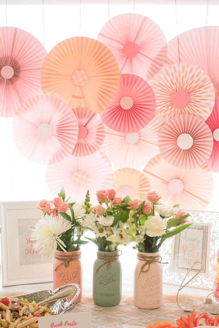 Gorgeous handmade rosette backdrop. Good thing she's got a talented mother-in-law! The rosettes created a lovely backdrop for the food table. - Sweet Little Peach Baby Shower   Halfpint Design