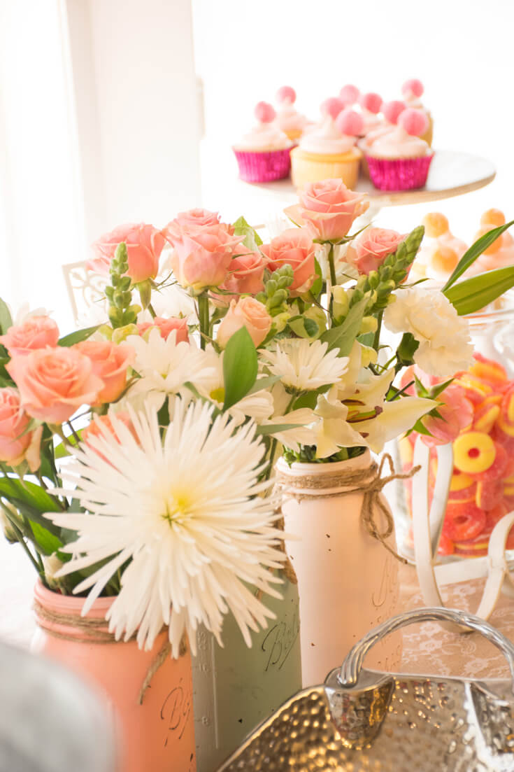 Baby shower centerpieces son't have to be expensive. For affordable centerpieces use painted Mason jars filled with fresh flowers. Costco and other grocery floral departments have surprisingly great selection at even better prices. My absolute flower fave??? Trader Joes! - Sweet Little Peach Baby Shower   Halfpint Design