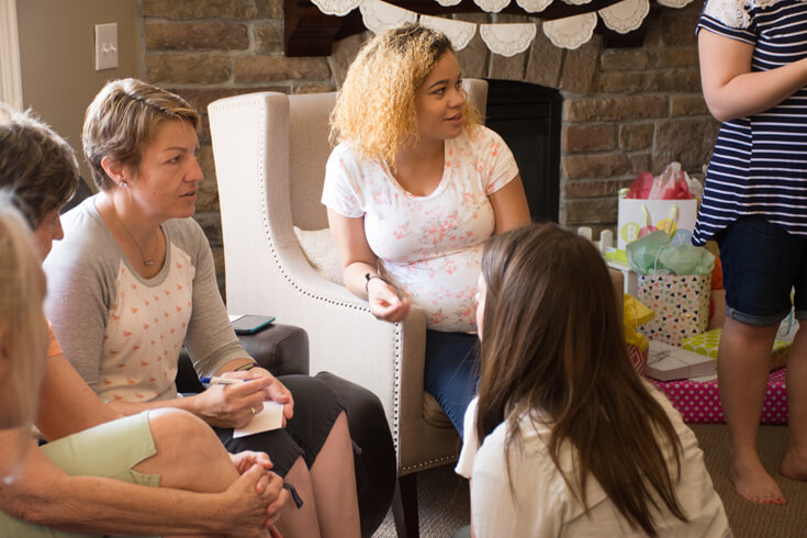 Mommy-to-be enjoying Baby Shower Jeopardy with her guests - Sweet Little Peach Baby Shower   Halfpint Design
