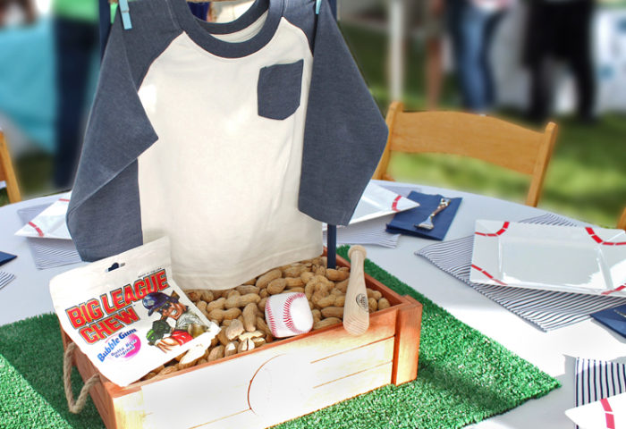 Creating centerpieces with baby clothes is a great idea! All the baseball details of this shower were fabulous! Love the Big League Chew! Yankees Baseball Themed Baby Shower | Halfpint Design - boy baby shower theme, baseball party