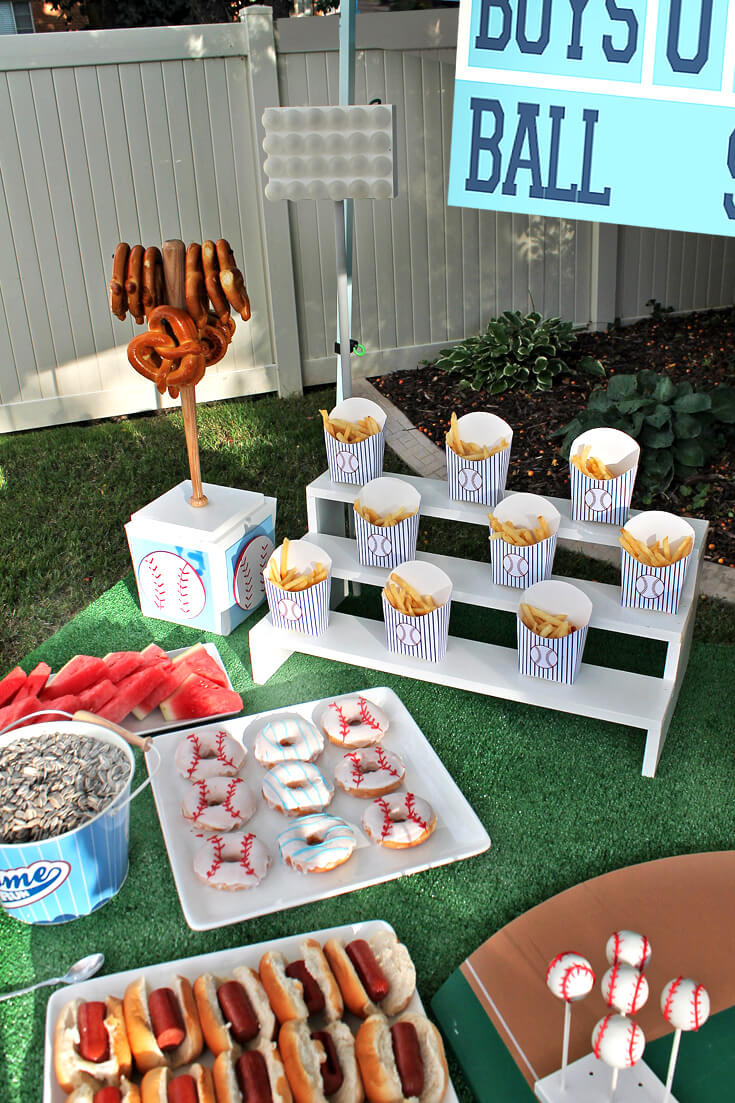 Baseball concession stand! Mini hot dogs, fries, popcorn, soft pretzels, and baseball donuts! Yankees Baseball Themed Baby Shower | Halfpint Design - boy baby shower theme, baseball party