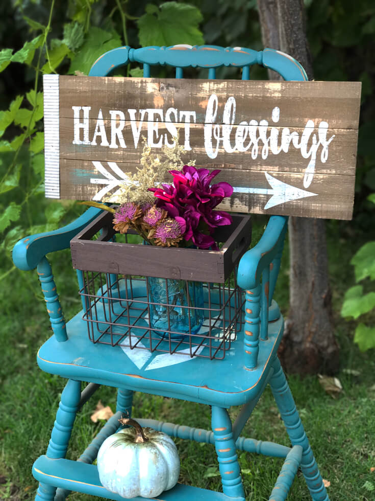 """Antique highchair with a rustic """"harvest blessings"""" sign guiding guests to the buffet. Farmer's Market Harvest Brunch 