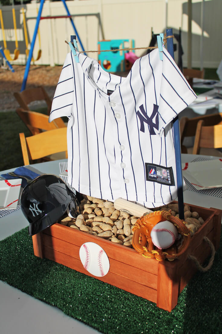 Creating centerpieces with baby clothes is a great idea! And that mini mitt!? Love it. All the baseball details of this shower were fabulous! Yankees Baseball Themed Baby Shower | Halfpint Design - boy baby shower theme, baseball party