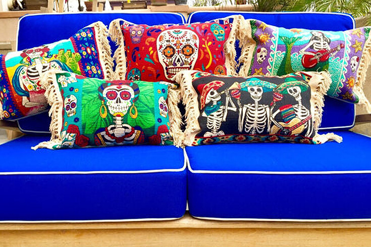 Day of the Dead pillows to spice up your house for the holidays. Dia de los Muertos Party Resources | Halfpint Design - Halloween party, party decorations, party clothes