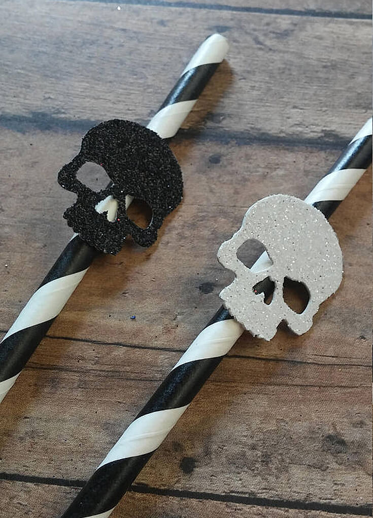 Skull party straws are a fun way to celebrate Day of the Dead. Dia de los Muertos Party Resources | Halfpint Design - Halloween party, party decorations, party clothes