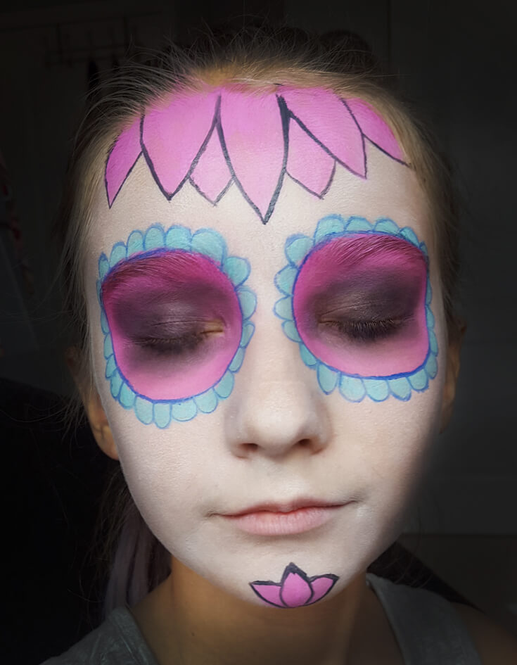 If you've ever wondered how to do cool sugar skull makeup for a day of the dead or Halloween party this tutorial is for YOU! SUPER easy, anyone can do it. Step 3 is creating flower petals on your forehead and chin then outlining everything with pencil. Sweet Sugar Skull Makeup Tutorial | Halfpint Design - party makeup, costume makeup, dia de los muertos