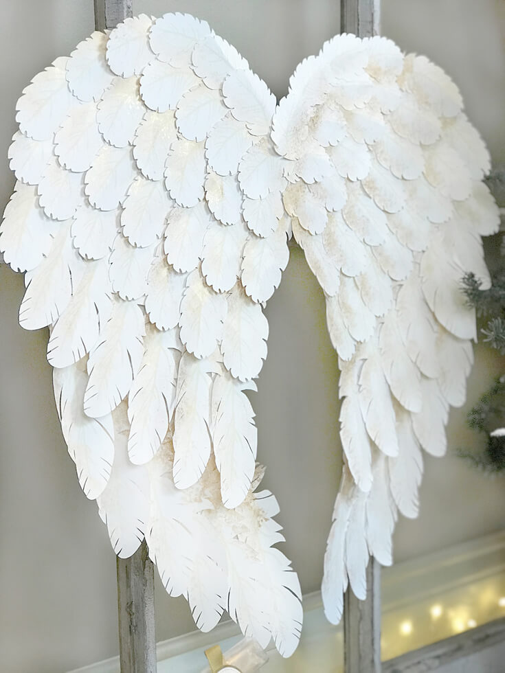 I created angel wings with my Cricut Explore Air for a Peace on Earth holiday display. Check out how I did it and grab the feather svg files to make some magic for your home! Holiday Angel Wing Tutorial at Halfpint Design. Great for Christmas, Easter, Halloween, Baby Showers, and general home decor.