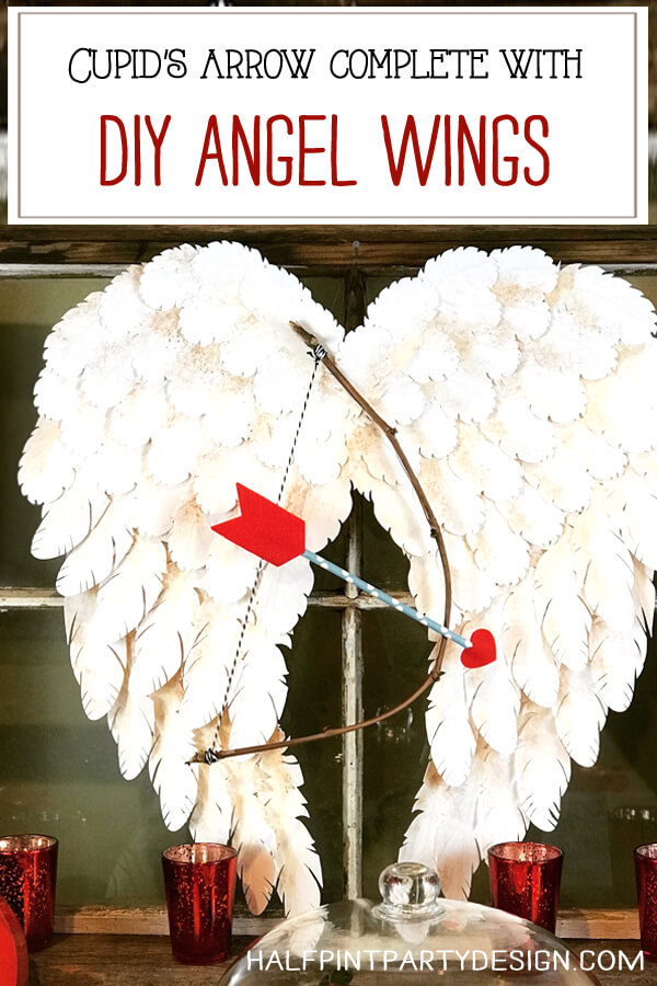 Paper crafted Angel wings with bow made from a branch and paper straw arrow. Perfect Cupid arrow for Valentine's Day, Bridal Shower, Engagement Party, or Wedding decor. Halfpint Party Design