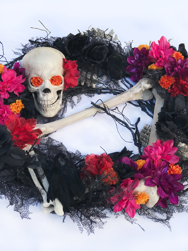 The finished Day of the Dead Wreath for a Coco viewing party! I love all the colors and how bright and cheery it has now become. Day of the Dead Holiday Wreath Transformation from Halfpint Design. Day of the Dead party, Dia de los Muertos decor, Decor DIY
