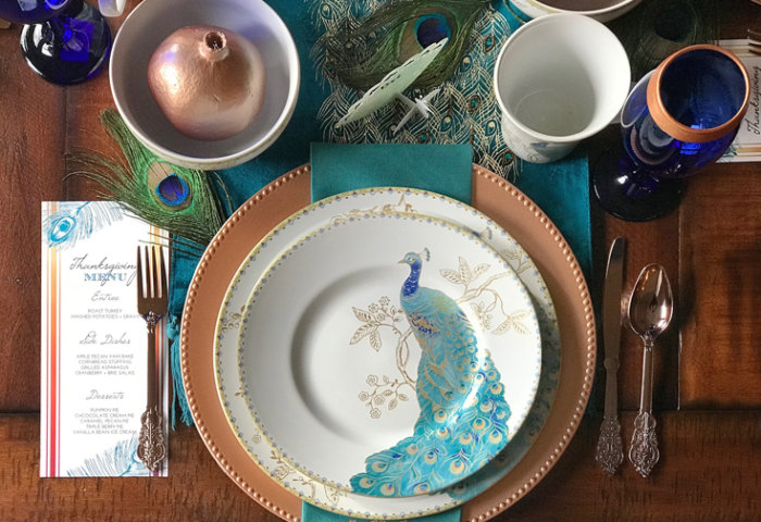 Peacock China, copper chargers, custom place cards with Far East flair makes for exotic Thanksgiving, Christmas, or dinner party table decor. Download the FREE editable Thanksgiving menu too! See more Global Chic Holiday Tablescape ideas at Halfpint Design. Thanksgiving Tablescape, Place setting, Christmas Table, Holiday decor.