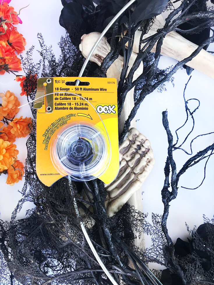 Aluminum wire is such a great tool to have in your DIY kit. I cuts easily, is strong, but still lightweight. Day of the Dead Holiday Wreath Transformation from Halfpint Design. Day of the Dead party, Dia de los Muertos decor, Decor DIY, Coco party