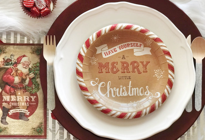 Looking for some good ol' fashioned Christmas decor? Layer paper dessert plates with glass dinner plates and a fun vintage print napkin. Check out all the details of this Cozy Cottage Christmas Tablescape on Halfpint Design. Farmhouse Style Christmas table, Vintage Christmas.