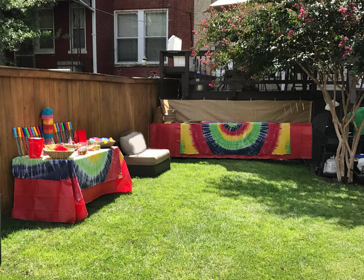 Backyard parties are the best with tie dye table clothes and Jamaican Catering.