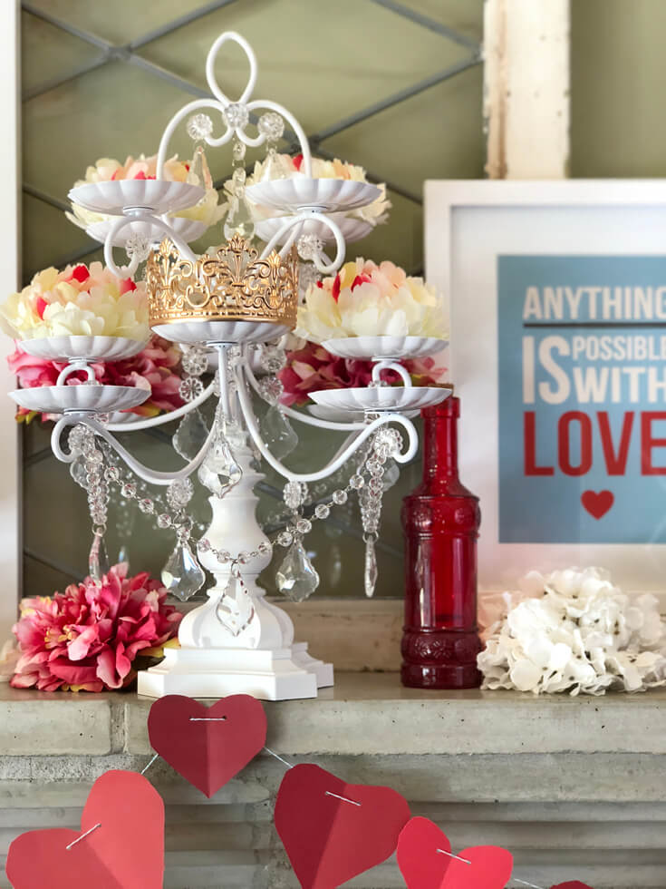 """Gorgeous white cupcake stand holding flowers and dripping with crystals. Quote """"Anything is possible with LOVE"""". Romantic Valentine's Day Mantel Decor on Halfpint Design."""