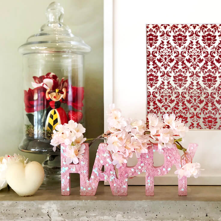Red Damask flocked paper with pink sequin wooden letters HAPPY and Queen of Hearts Terrarium. Romantic Valentine's Day mantel decor on Halfpint Design.