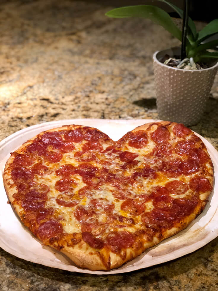 Heart shaped pizzas are perfect for the family on Valentines. Last Minute Valentines Day Party Food Ideas on Halfpint Design. Red food