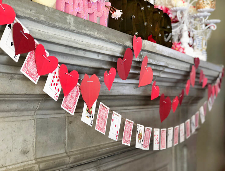 Kid cut hearts for fireplace garland. Playing card garland. Romantic Valentine's Day Mantel Decor on Halfpint Design.