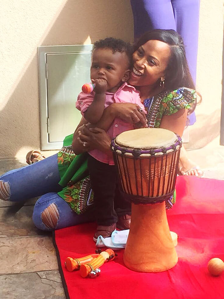 Mom and baby enjoying music with bongo. ONE LOVE first birthday party.
